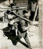 1973-two-teenage-viet-cong-soldiers-at-camp-near-cai-lay-one-carrying-a-captured-u-s-automatic-weapon-the-other-an